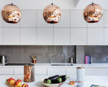 A Modern Kitchen Decor with Copper Lamps and Vintage Details